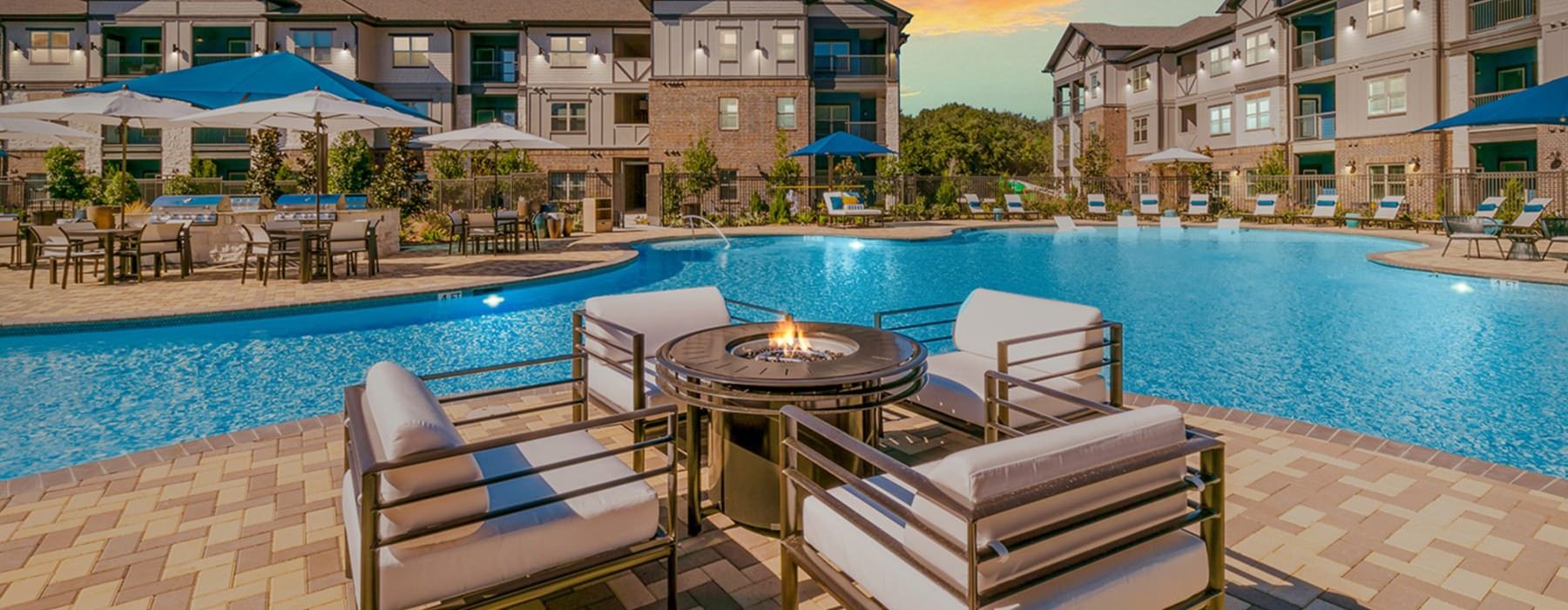 Spacious sparkling pool with sundecks, cabanas and a fire pit.